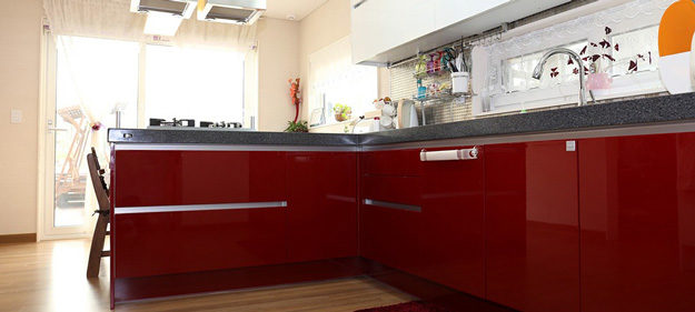 Kitchen counters with red cabinet fronts
